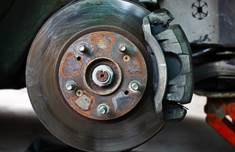 What are the causes behind the brake rotor wrap?